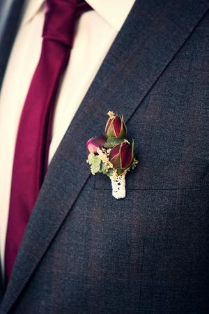 rose bush: rose bush boutonniere on grooms grey suit