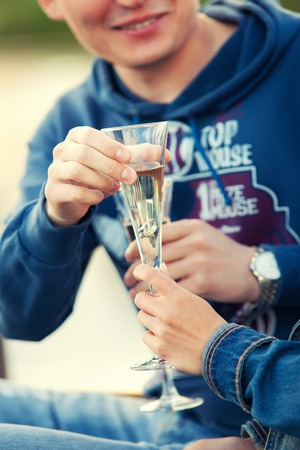 proposing: man makes a proposal to the girl and gives her a ring in a glass of champagne