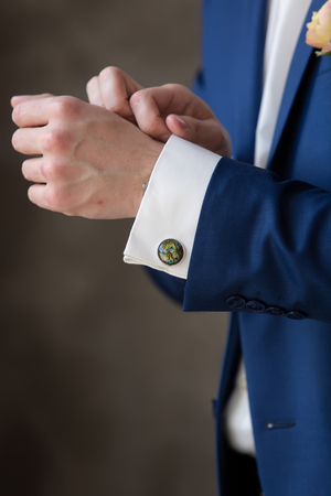 cuff link: cufflinks groom a peacock feather Stock Photo