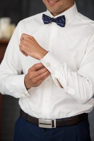 cufflink: the groom dresses cuff links in wedding day Stock Photo