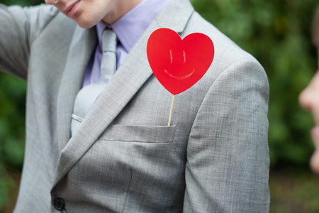 smilie: the plate in the form of heart in a pocket at the man