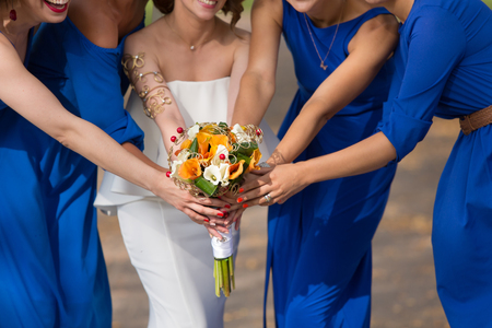 bridesmaids: bridesmaids in blue dresses with a bouquet Stock Photo