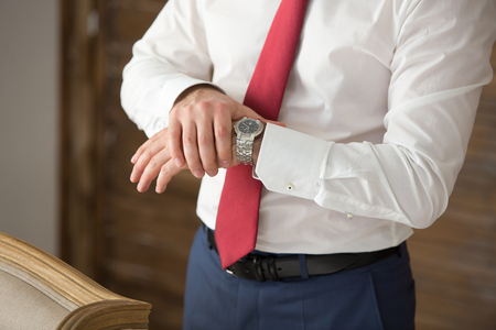 mans watch: mens watch on the mans hands in a suit Stock Photo