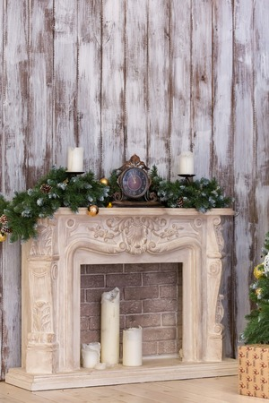stone  fireplace: the stone fireplace decorated with a New Years decor