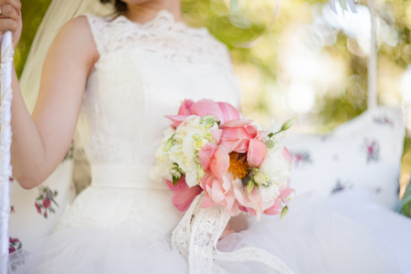 color in: bridal bouquet of pink color in hands