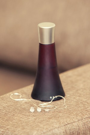 claret: womens perfume of claret color and jewelry