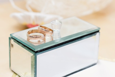 casket: gold wedding rings and mirror casket Stock Photo