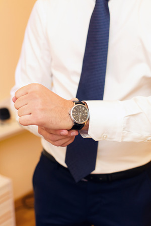 suit  cuff: stylish watch on a hand at the man Stock Photo