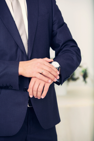 cuff link: stylish watch on a hand at the man Stock Photo
