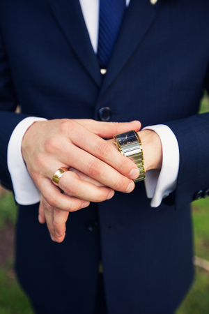 cuff link: expensive watch at the groom in a suit