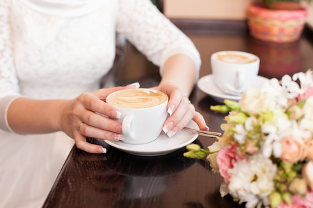 enchantment: bride and a cup of coffee in hands