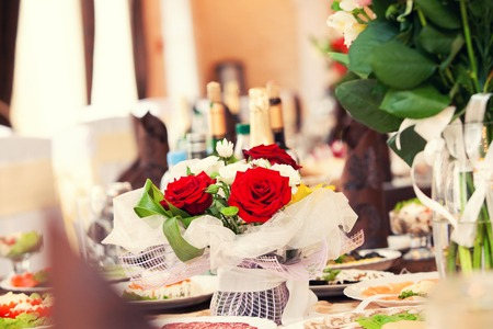 holiday table and red roses