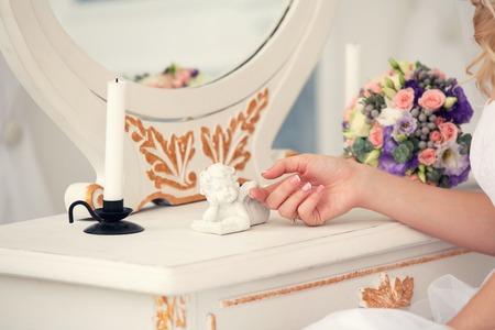 angel girl: dressing table for the girl and a figure of an angel