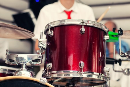 the drummer plays percussion instruments Stock Photo