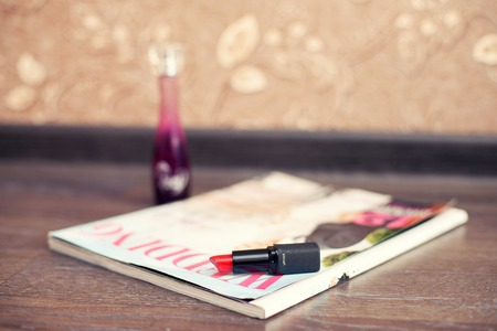 chap sticks: womens lipstick of pink color and magazine of fashion