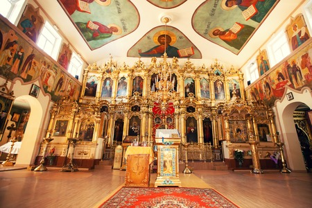 iconostasis: Interior of Orthodox Christian church - altar, iconostasis, and beautiful icons, frescoes in natural lighting.