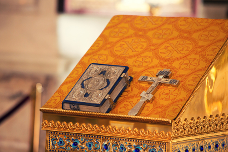 bible altar: Interior of a very small chapel with holy bible, golden cross