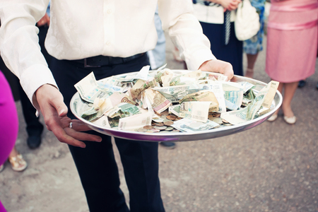 Russian money on the silver tray in the guests hands