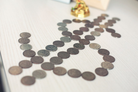 roubles: russian roubles coins on banknotes of dollars Stock Photo