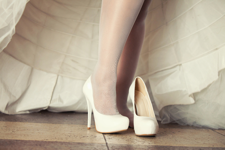 getting: The bride getting her wedding shoes on