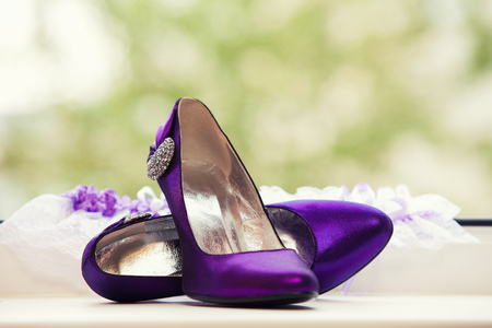 stilletto: Womens purple patent high heels on green nature background