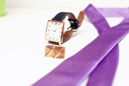 cuff: watch, violet tie and cuff links. Grooms accessories Stock Photo
