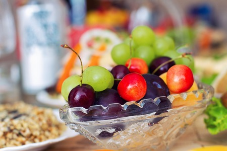 adn: tasty summer fruits in a glass vase. Cherry adn  strawberry, sweet cherry, grapes, Foto de archivo