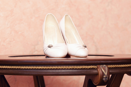 no heels: white shoes on wooden table