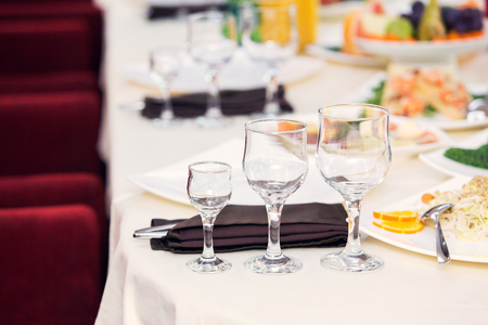 Empty glasses in restaurant. Table setting for celebration Stock Photo