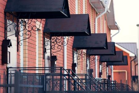 neighbourhood: Terraced Red Brick Houses on an Street. neighbourhood. real estate