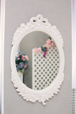 mirror frame: Round vintage mirror frame on the bedrooms wall Stock Photo