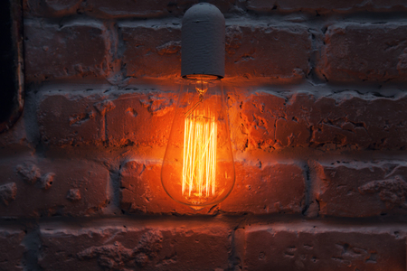 incandescent: Incandescent lamps on a brick wall background.