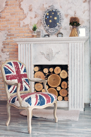 British flag armchair placed in British style interior with fireplace