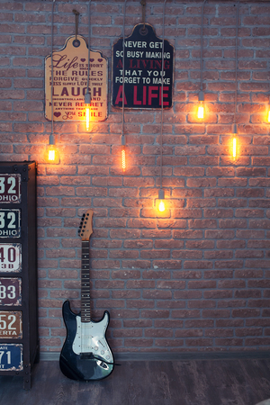 Electric guitar on a brick wall background. Grunge style