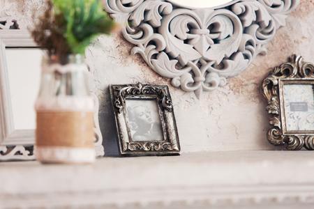 Vintage photo frame on table over grunge background Stock Photo