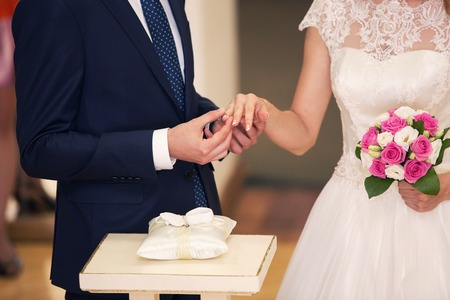 commit: the groom dresses a ring to the bride. Wedding