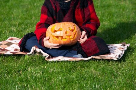 cruel: Happy child, caucasian boy, carving pumpkin for halloween
