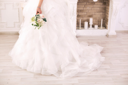 bride dress: beautiful dress of the bride in white studio and a bouquet Stock Photo