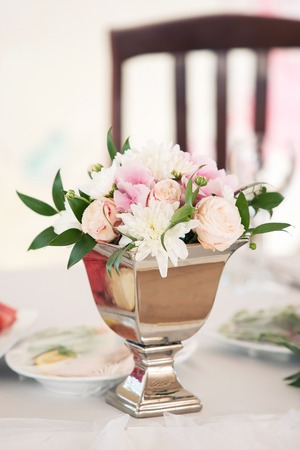 flower decoration on a wedding table for the newlywed