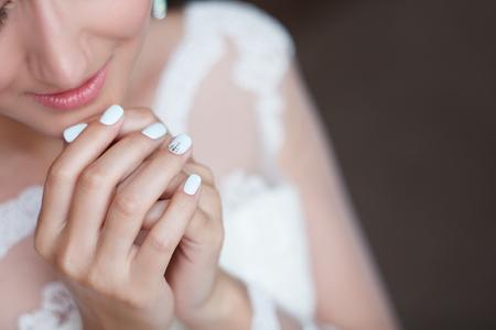 beautiful wedding manicure of the bride close up