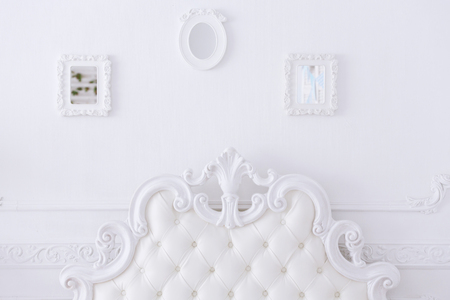 Detail of a white bed in a light bedroom