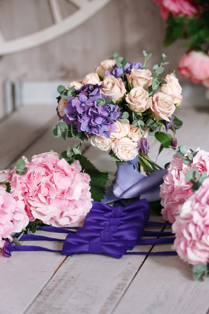 bridal bouquet from roses and hydrangea and bow-tie for grooms friends