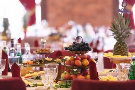 catering table set service with silverware and glass. Delicacy fruit