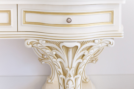 White dressing table in a living room. Modern classics with rococo elements.