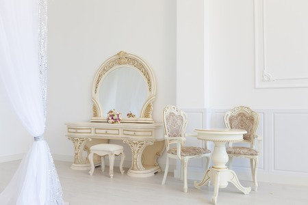 Light interior of the room in classical style. White furniture, dressing table.