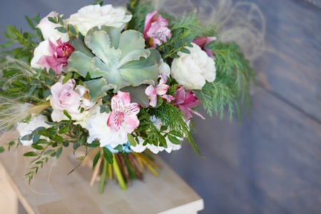 gentle bridal bouquet in style a rustic. Succulents, pink roses and greenery Foto de archivo