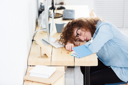 Tired young progect architect sleeps at work place, has deadline, work all night at construction or business project. People, work, tiredness concept Reklamní fotografie