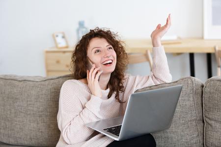 Charming glad caucasian female freelancer has phone conversation, surfing high-speed internet on laptop pc. People, technology, lifestyle Stock fotó