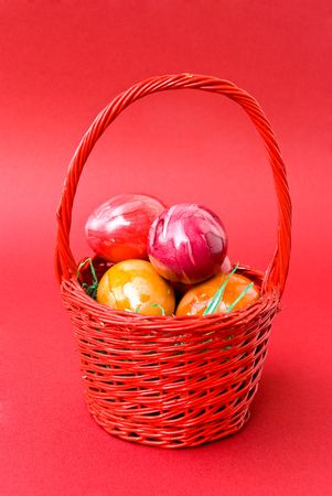 colorful eastern eggs in the red basket photo