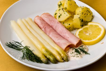 ham with asparagus and potatoes photo